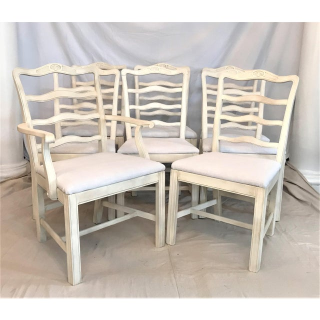 These stylized ladder back dining chairs make a beautiful presentation with simple, timeless, and elegant lines. They...