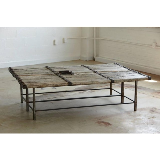 Pair of large antique Chinese gate doors as a coffee table. Beautiful weathered surface with hand-forged metal...