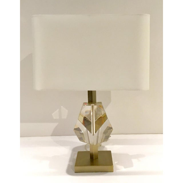 Stylish Arteriors Modern Geometric Champagne Crystal Table Lamp, champagne metal frame with an elegant crystal prism,...