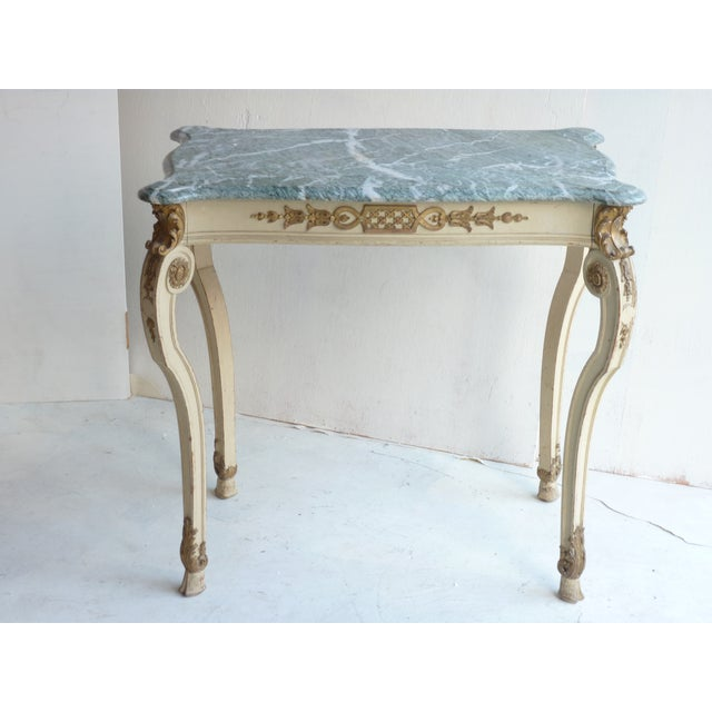 Offered is a Louis XV style Austrian center table. This striking piece features a curved sea-green marble top, hoof feet,...