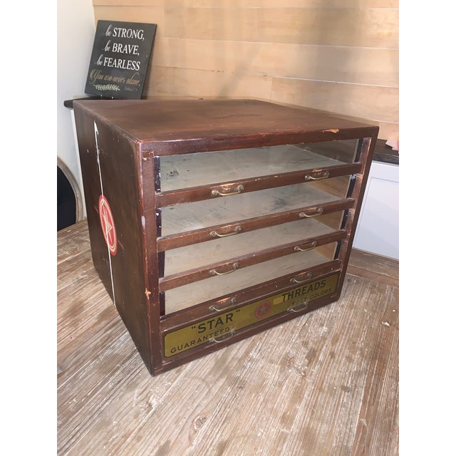 Antique Star Thread 5 Drawer Table display case. Wood Construction with glass front drawers, and metal drawer pulls. Five-...