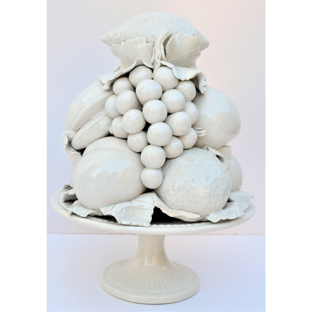 This is a beautiful blanc de chine creamy glazed ceramic fruit topiary tower. This is a mid century piece that was hand...