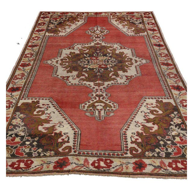 Vintage Turkish Oushak rug with traditional style. This hand-knotted wool rug features an elaborate central medallion on...