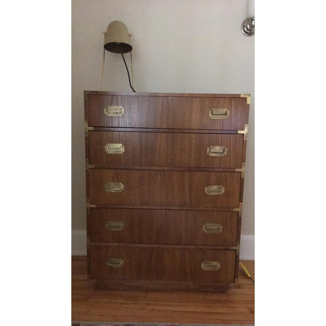 Beautiful Dixie Campaigner 5-drawer dresser. Circa 1960's. Wood with gloss finish and brass hardware. Five dovetail...