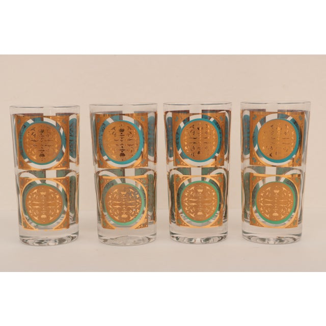 Mid-century Georges Briard-style gold-touched glasses with aqua blue and seafoam green accents. These tumblers have a...