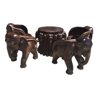 Carved Elephant Table and Four Chairs