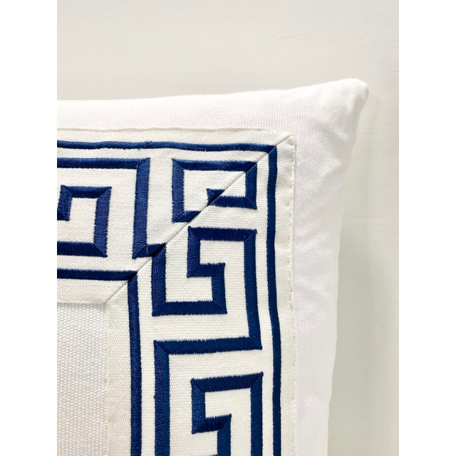 These are custom made in Houston, Texas. They are down filled and have a navy Greek key trim applied.