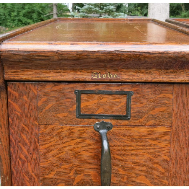 """Antique Globe Oak File cabinet set of three. Center one has no sides but 2 end ones are double sided. They are 55.5"""" high..."""