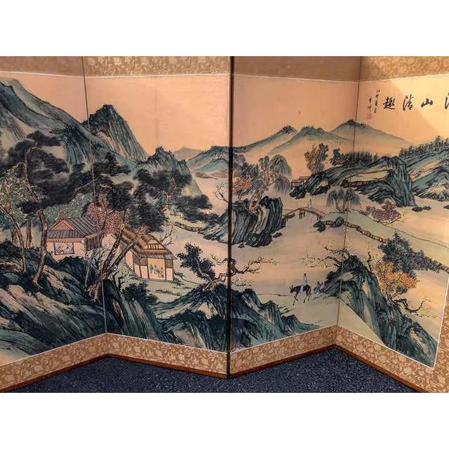 Add a touch of asian glam to your room with this silk hand painted folding screen. Depicts a beautiful Asian scene with...