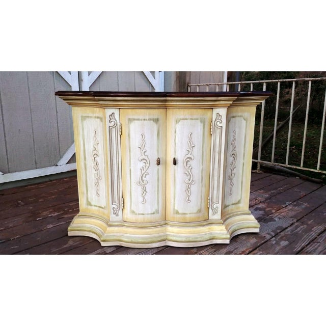 Item offered is a vintage 1970's - 1980's Drexel Heritage Mediterranean style 2 door console cabinet. It has a painted...