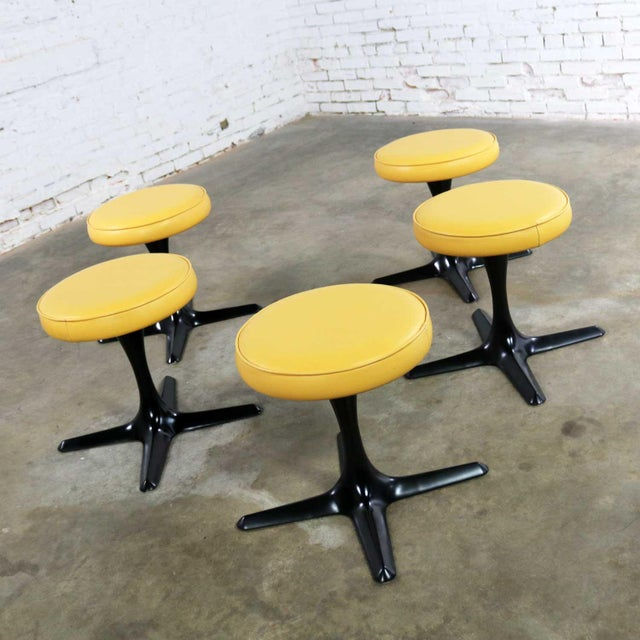 Fabulous set of 5 mid-century modern tulip style swivel low stools by Burke Division for Brunswick. They have their...