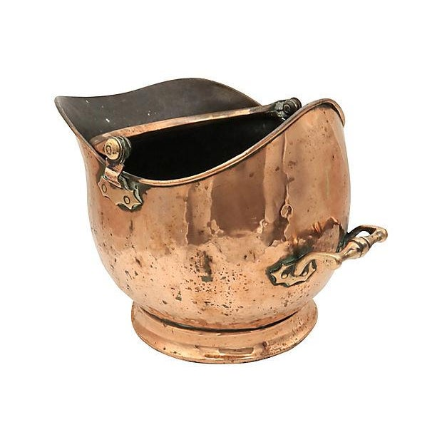 Large antique English copper coal scuttle. Hand forged construction, heavy handle. No maker's mark. Light wear.