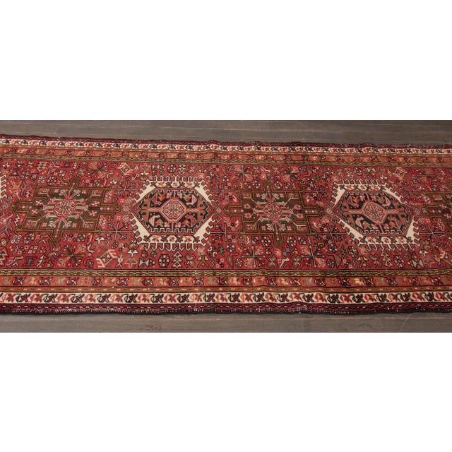 Vintage hand-knotted Heriz with a geometric design on a rust field with beige borders. This rug has magnificent detailing...