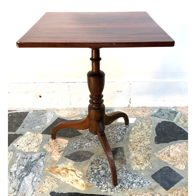A quality, 19th century tilt top candle stand with solid mahogany square top. Top has recently been refinished and reveals...