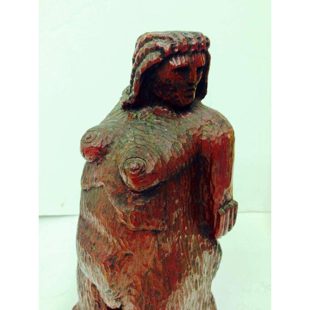 A uniquely stylized direct wood carving of a nude woman. Unfortunately I cannot find any signature. Well executed.