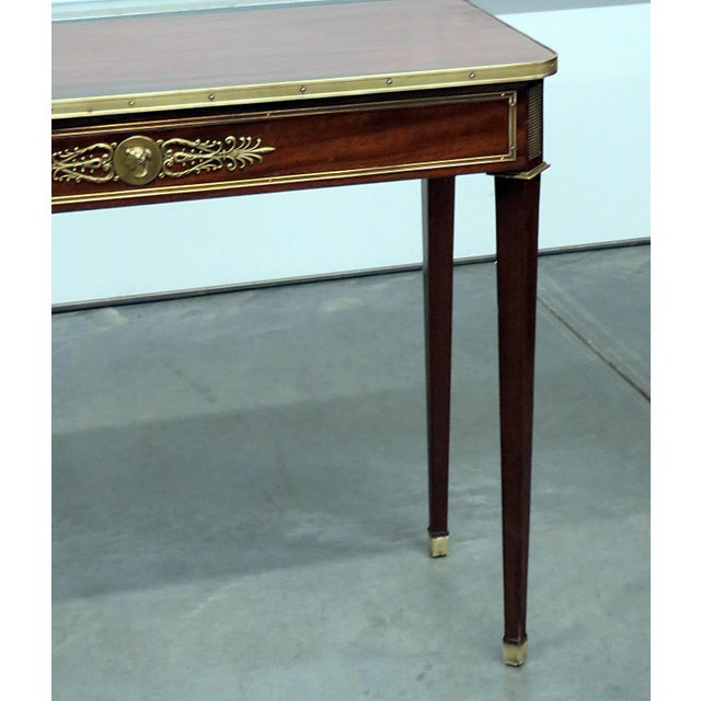 Directoire style console table with bronze mounts. Made in the mid 20th century.