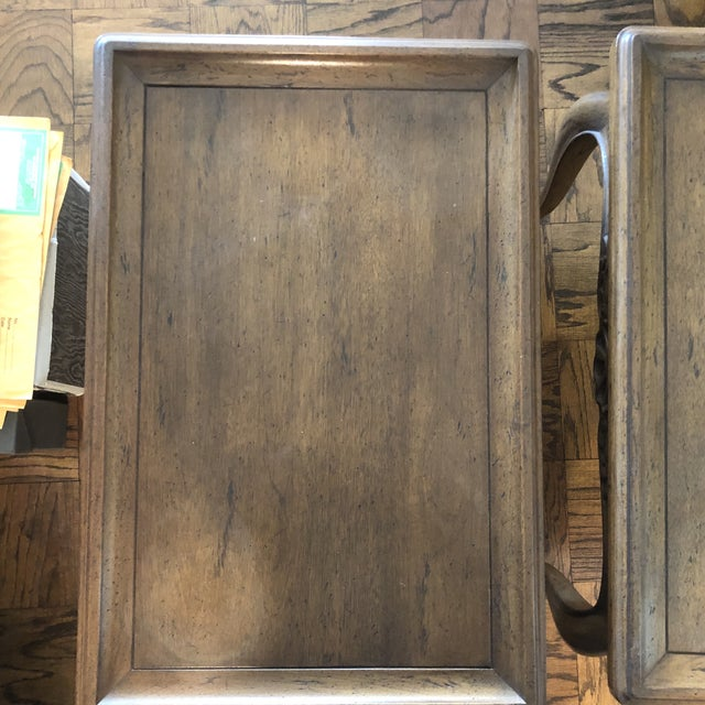 Lovely pair of mint condition French style wood end tables. Details include: carved feet, apron with shell pattern and...