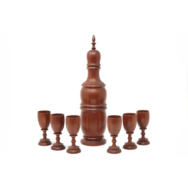 "A mid-century ""turned"" rosewood or mahogany wood decanter and cups set. Excellent condition, consistent with age and use...."