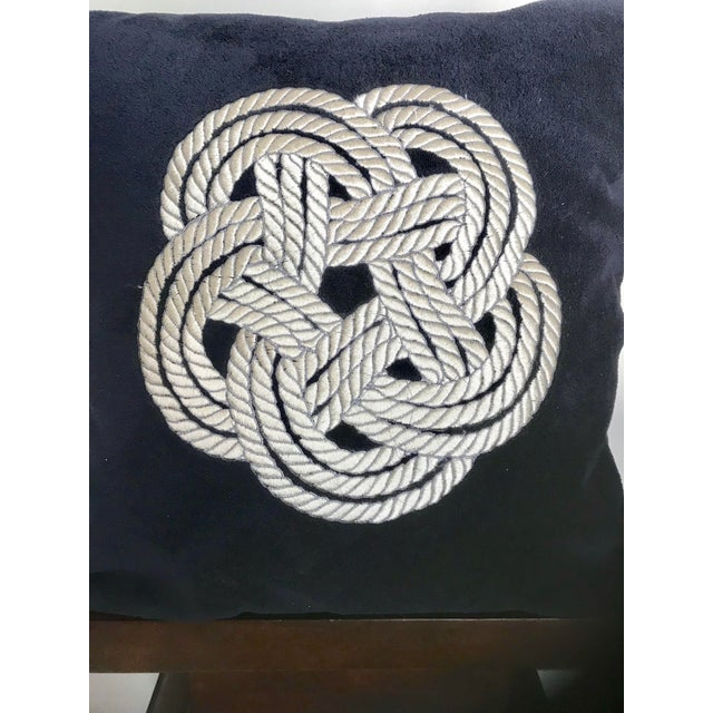 This is a pair of navy velvet pillows with cream knot embroidery. They're great for a beach house or modern setting.