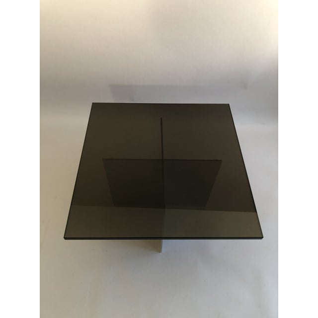 "Paul Mayen small coffee table for Habitat, ca. 1970. Aluminum slotted X base (18"" L x 18"" D x 15"" H) with black glass 3/4""..."