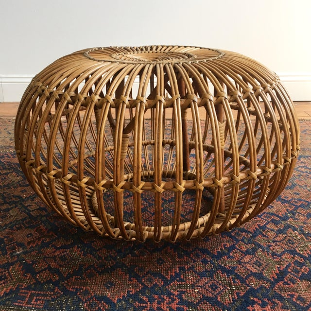 A nice vintage example of timeless Italian design. In 1951, Franco Albini designed an ottoman made of rattan, which is an...