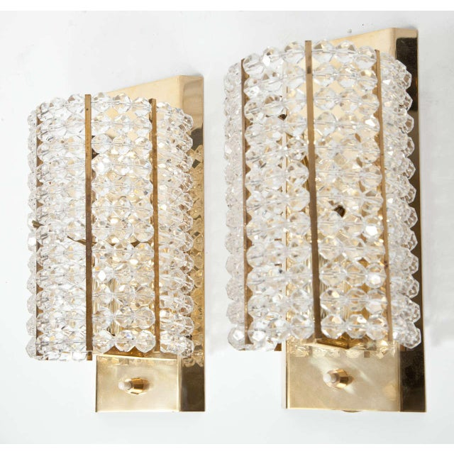 A striking pair of sconces made up of Lucite beads on a brass frame. Perfect for a small space or powder room. Newly rewired.