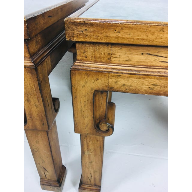 This is a pair of walnut Asian inspired contemporary side tables. The top of each table has an antique mirror inset. These...