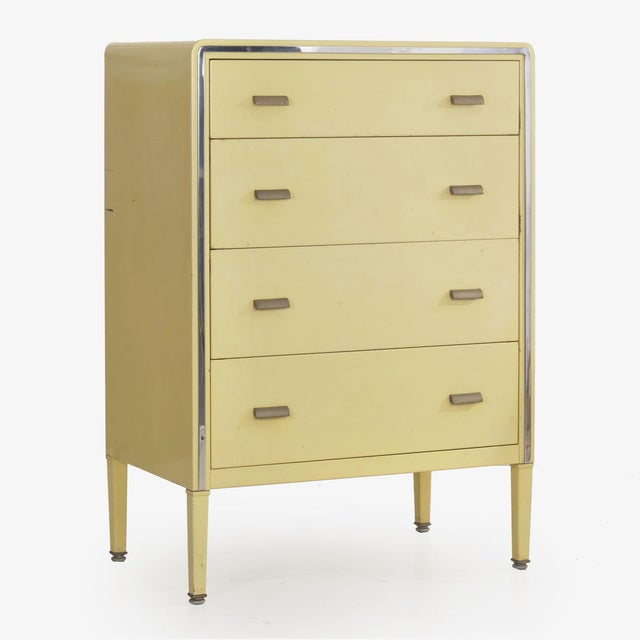A rare original high chest of drawers in yellow enameled steel designed by Norman Bel Geddes for Simmons in the 1930s, the...