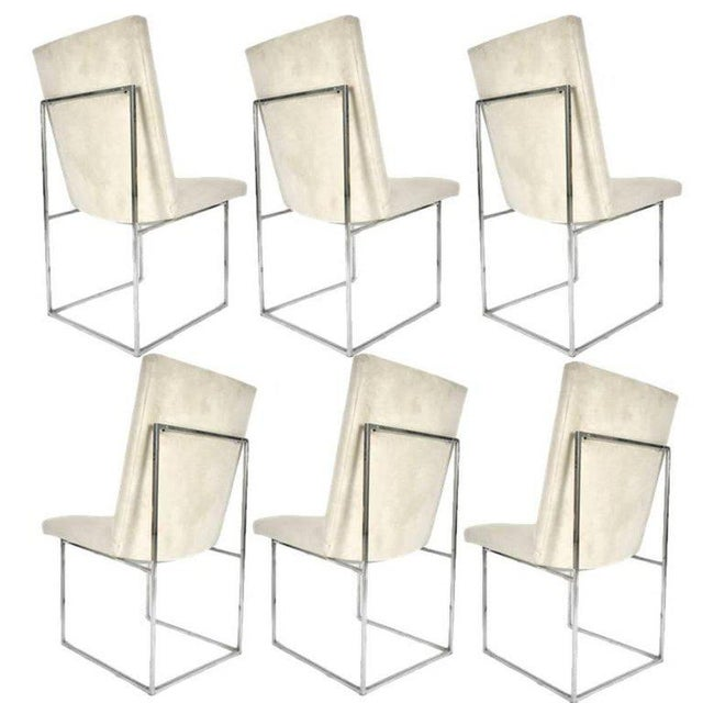 One of Milo Baughman's more iconic designs. These dining chairs have a stunning architectural base of polished chrome...
