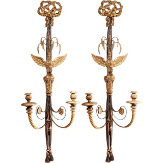 Pair of Large Italian Black Painted and Parcel Gilt Two Light Sconces For Sale