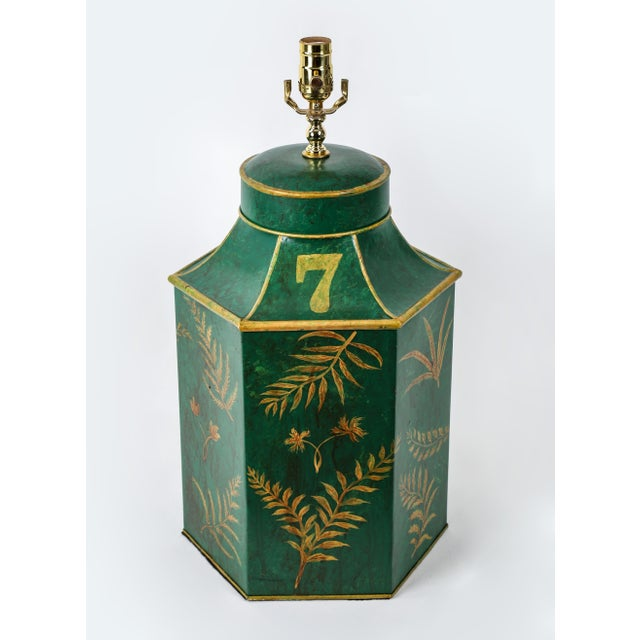 The medal hexagonal green tea caddy lamp hand-painted various gold ferns leave .The number 7 represents style of tea...