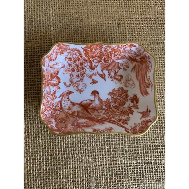 """Vintage Royal Crown Derby trinket dish made of fine white bone china decorated with the """"Red Aves"""" pattern and a delicate..."""