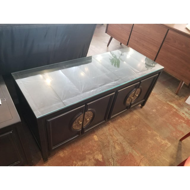 This is an authentic Century Furniture piece in the style of James Mont with beautiful brass hardware and black lacquer...