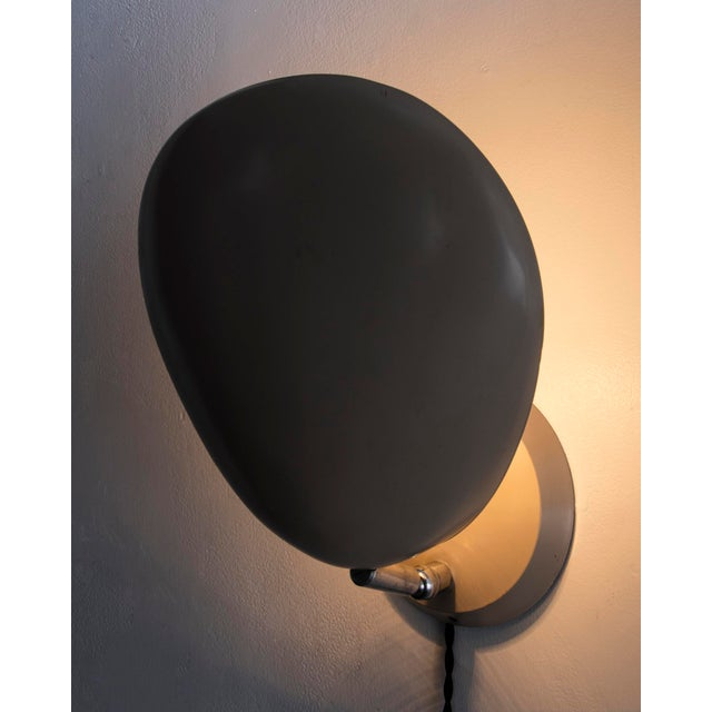 """Cobra"" wall-mounted lamp in aluminum and steel, original paint in excellent condition. Designed by Greta Magnusson..."