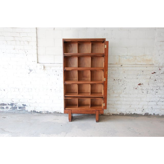 Offering a very unique mid-century oak barrister bookcase. The bookcase features gorgeous oak wood grain and exposed...