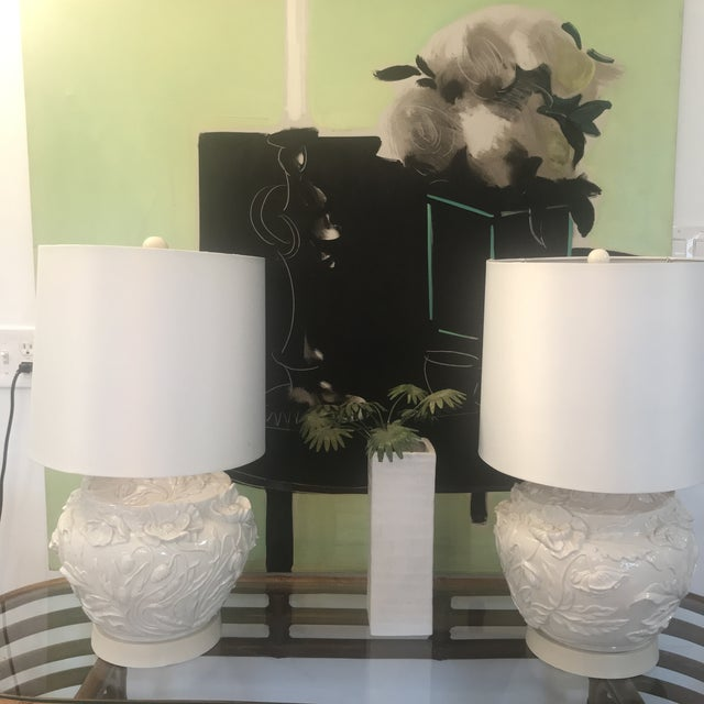 "Gorgeous pair of white porcelain Italian lamps with raised flower relief. Original label ""Italia Imports hand made in..."