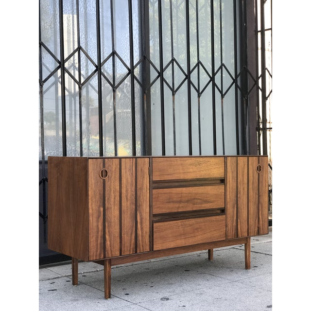 Distinctive Furniture Credenza by Stanley Furniture Co. Made of walnut wood and rosewood inlays. Spacious credenza...