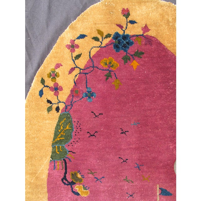 Alive with color, this beautiful oval-shaped, antique Art Deco Chinese rug (circa 1920) features a traditional Chinese...