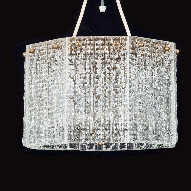 """A Pendant by Carl Fagerlund for Orrefors. Sweden, Circa 1960th. Textured glass and brass hardware. Diam. 12""""; Glass H- 7""""..."""
