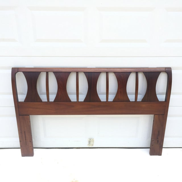 This stylish mid-century headboard features rich Vintage finish and original Kent Coffey design. At 60 inches wide this...