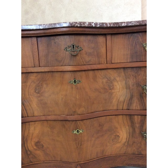 If you want a great looking piece but drawers that work well, this is it. Beautiful walnut, brass hardware and scroll...