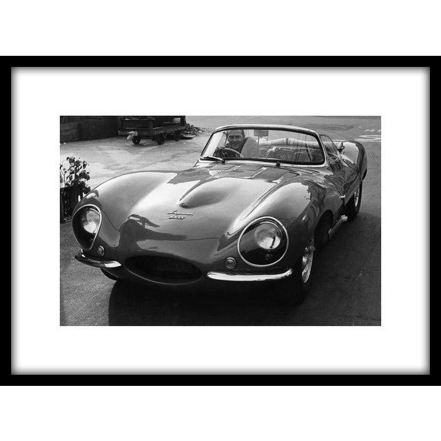 "Steve McQueen in his 1957 XK SS Jaguar on the lot of Goldwyn studio in Hollywood, 1960. 11"" x 14"" silver gelatin fiber..."