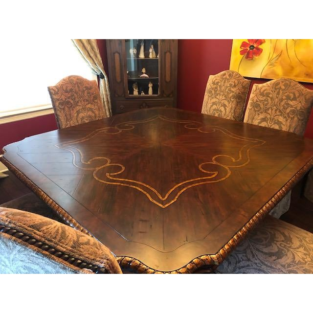 Elegant square solid wood dining table with 8 Classic Skirted Parson Chairs.. This table and chairs were purchased new and...