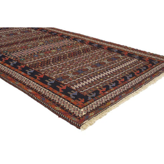 76999 Vintage Soumak Persian Rug With Tribal Style. This hand-woven vintage Persian Soumak rug features a series of...