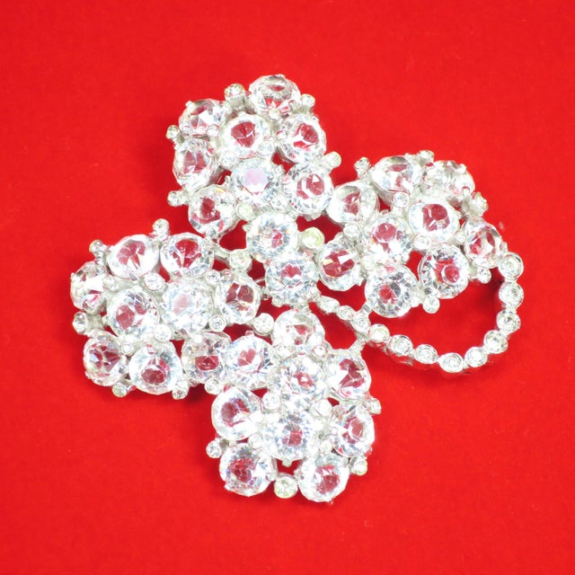 Offered here is a Reja rhodium-plated sterling and cut-crystal brooch from the 1940s. The three-dimensional design...
