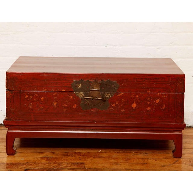 This Chinese red lacquered trunk was made during the, late 19th century, and is raised on a custom-made modern stand. The...