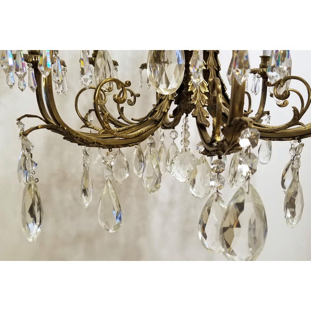 C. 1920, Louis XVI, 2 Level Bronze & Crystal, 12 lights Chandelier. Dimensions do not include canopy and chain. Weight 40...