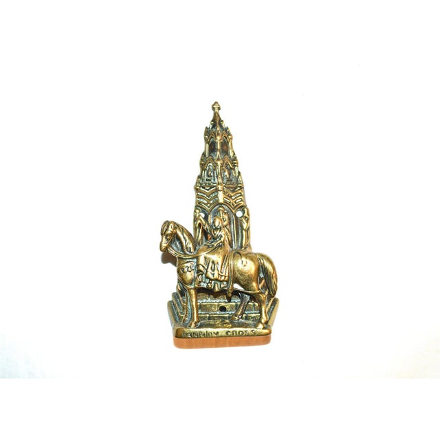 A nicely detailed vintage brass door knocker, made in Britain. It features St. Brigid of Ireland on a horse, with a cross...