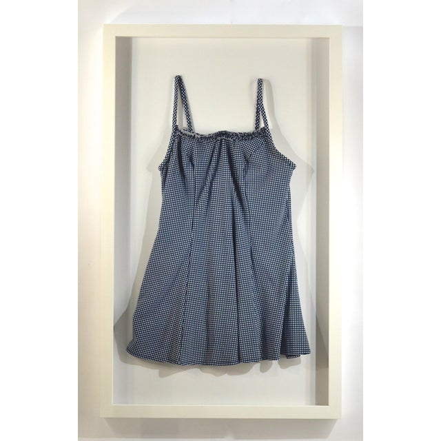 Framed Vintage Blue & White Chex Swim Suit. Suit is a dark blue with small ruffle across the top. Custom made wood shadow...