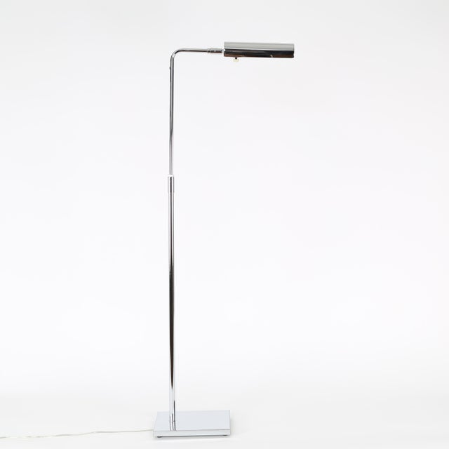 Versatile chrome floor lamp with slender neck and weighted base by Koch & Lowy. Produced in theUSA, circa 1970s....